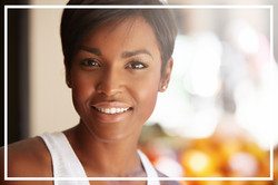 Portrait Of Beautiful Happy Young Black Model With Short Pixie Hairstyle And Healthy Clean Skin Look