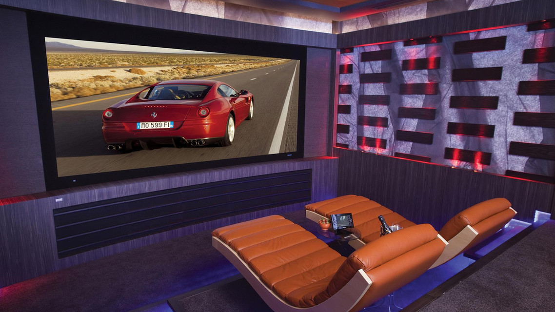 Extra large projection screen with cinema furniture and 4K plus control using an iphone or ipad