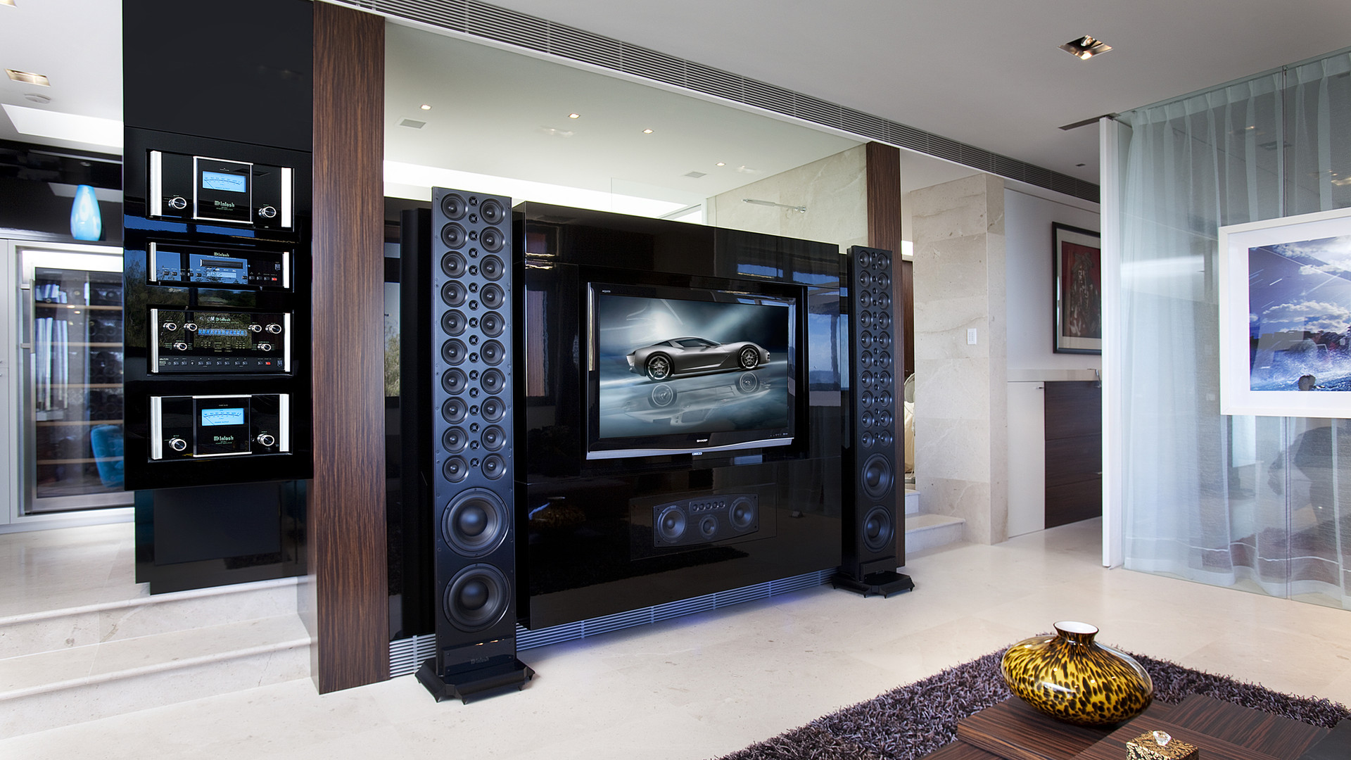Big sound with big speakers and LED display panel with lighting control and security using a single app for control