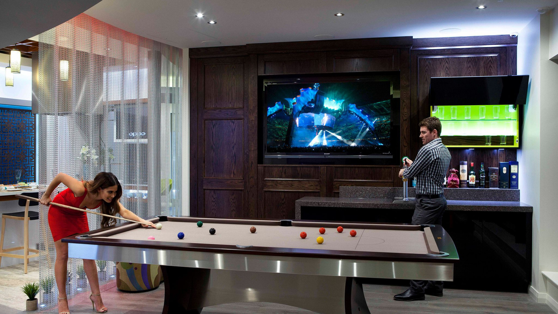 Man cave with lighting control, LED display panel with 4K content and control using a single app from an iphone or ipad
