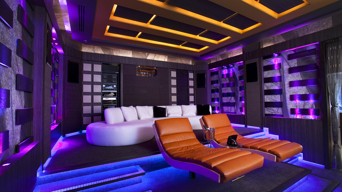 Home Cinema design with projection and large format screen with cinema furniture