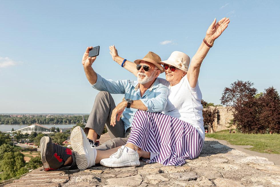 woman-raising-her-hands-while-taking-selfie.jpg