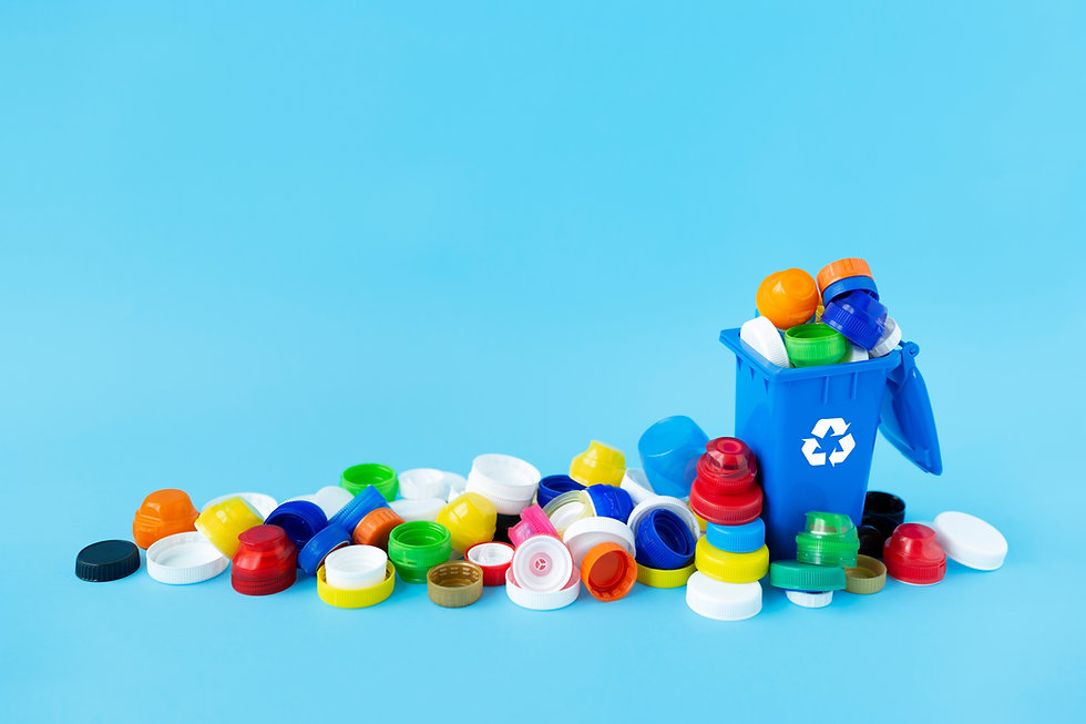 miniature-recycling-container-filled-with-plastic-bottle-caps-of-different-sizes-shapes-an