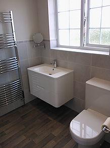 White gloss wall hung basin