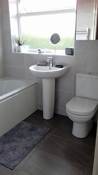 Dunstable, complete bathroom renovation, light grey wall tiles, dark grey large format floor tiles