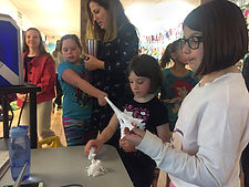 Students and staff examine 3D printed objects