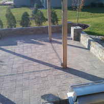 square patio with wall and pilars.jpg