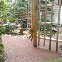 Pavers and pond through wood gate.jpg