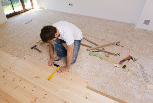graphicstock-man-measuring-wood-flooring