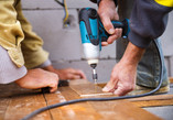 graphicstock-handymen-installing-wooden-
