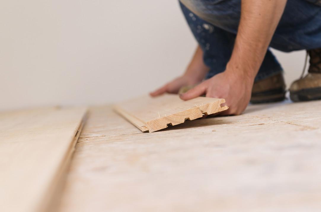 graphicstock-handyman-installing-wooden-
