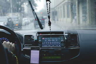 Canva - Photo of Person Driving Car Whil