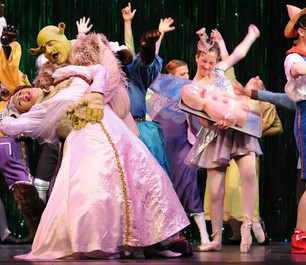 Shrek the Musical (right, holding cookie)