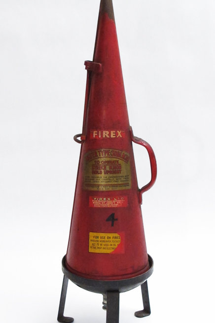 Vintage fire extinguisher with original stand
