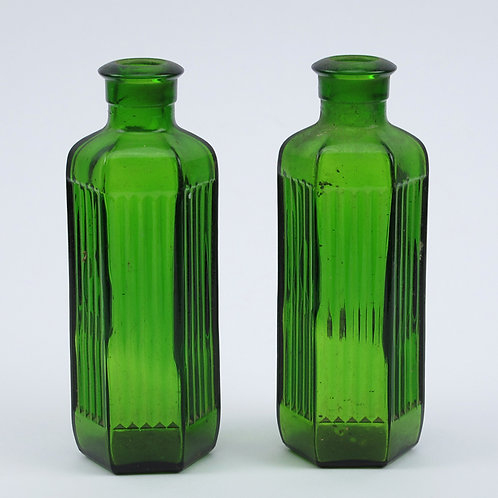 Small green glass bottles