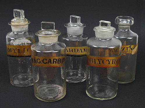 Collection of clear glass apothecary bottles