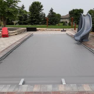 Fiberglass Pool with Gray Automatic Pool