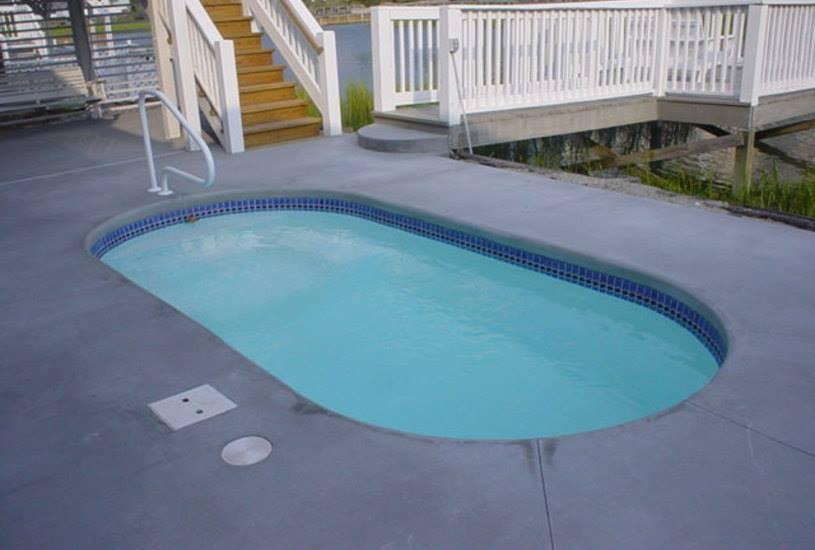 Basic Fiberglass Pool with broom finished concrete