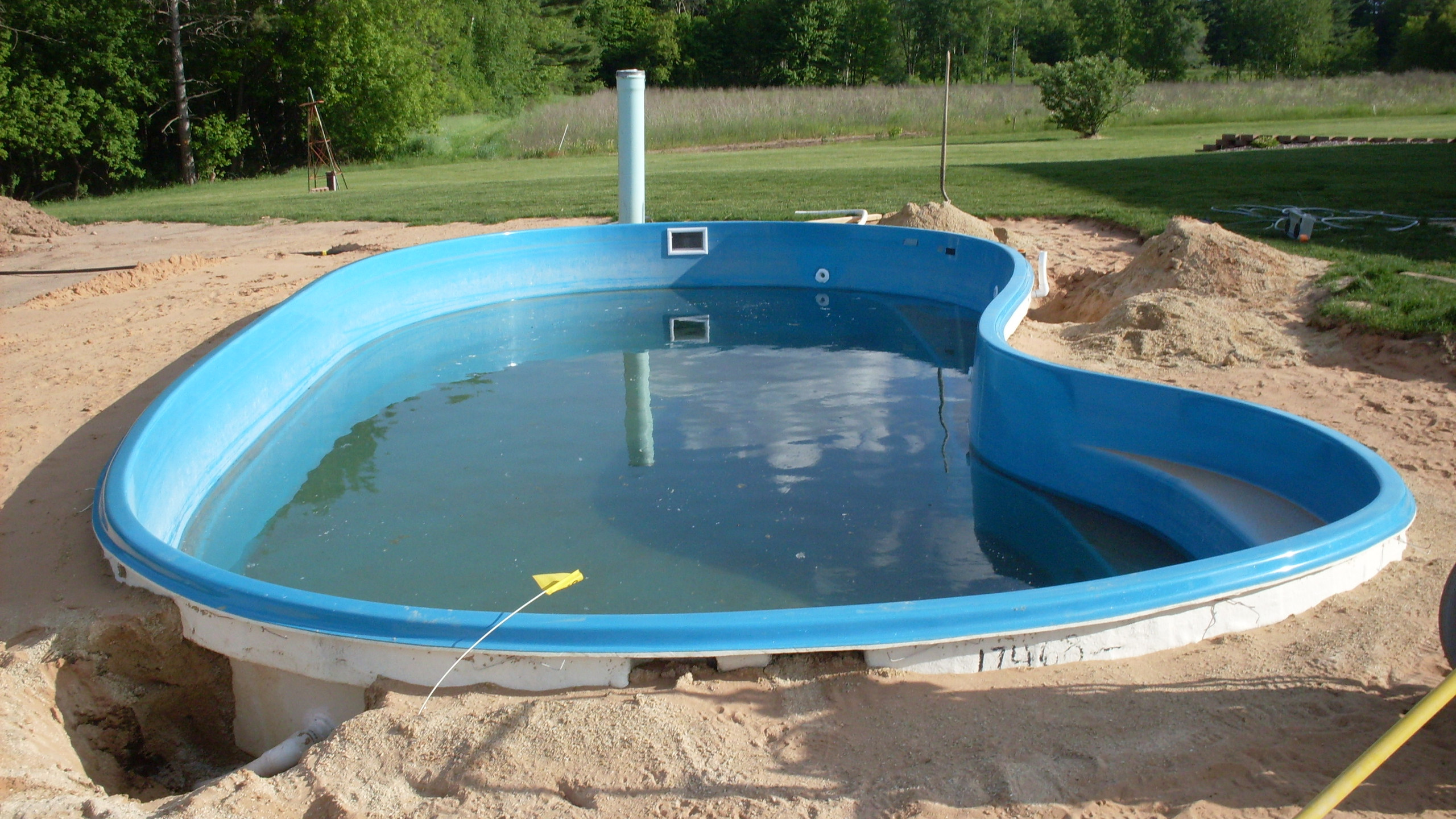 This is another fiberglass pool built by Siesta Creations. This pool was built in Shawano WI. Siesta Pools never pressure tested the plumbign and lef the homeowner with leaking fitting throuought the entire pool. All the fittings had to be removed, the pool wall sanded and new fittings installed and pressure tested.