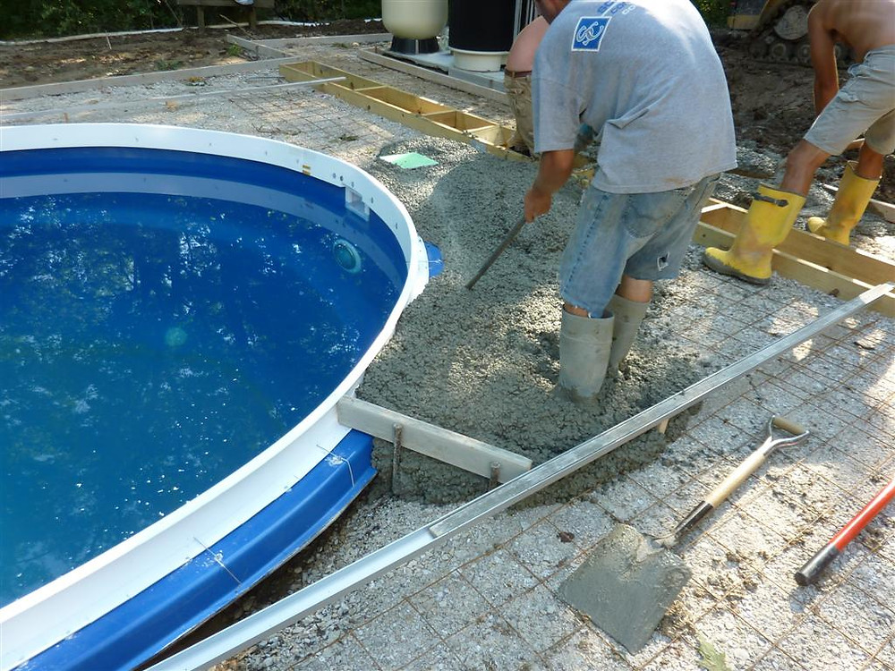 Cantilevered Concrete Pool Coping being vibrated into a disposable stegmeier concrete form.