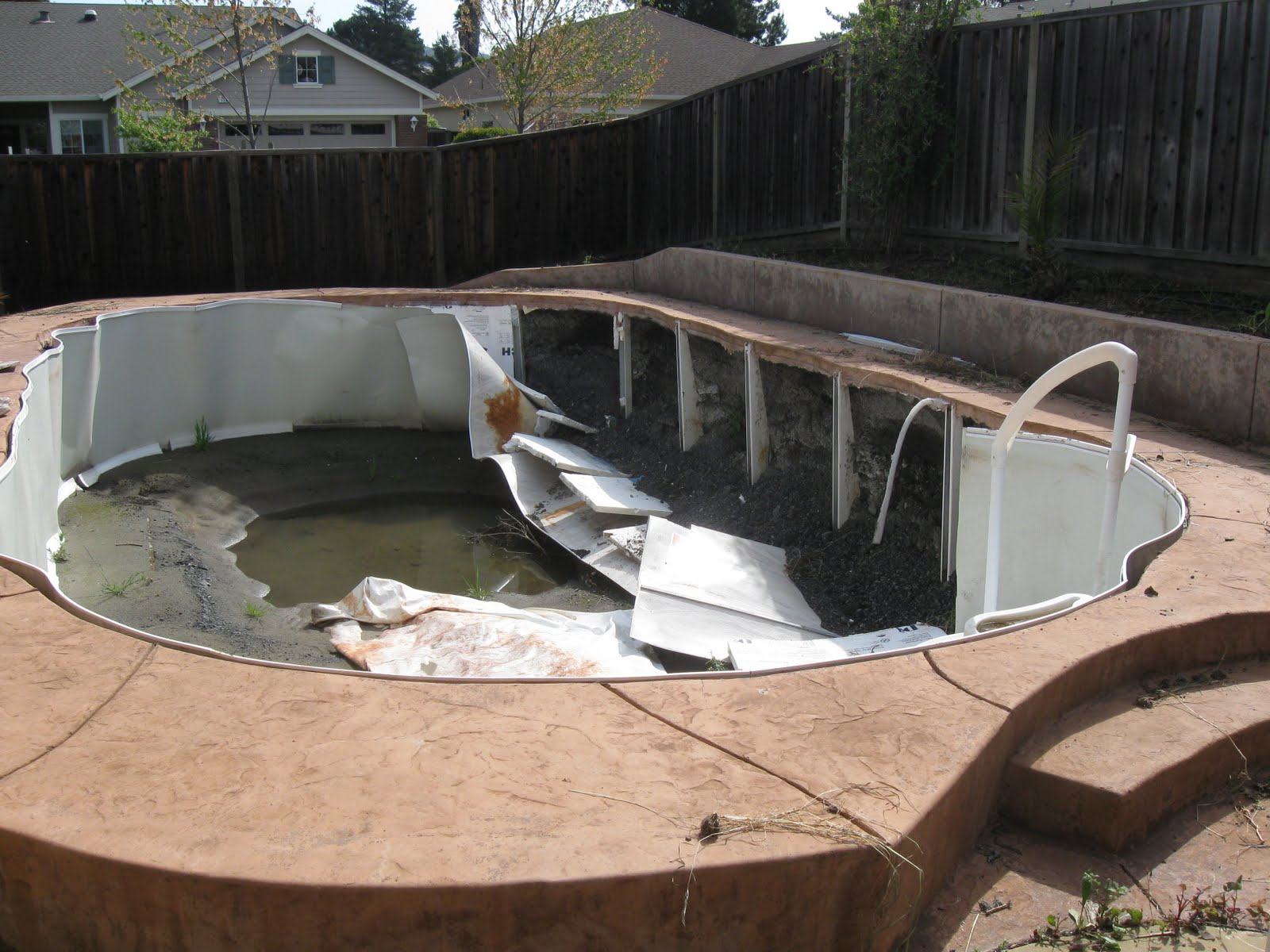 This above ground pool that was buried collapsed under the weight of the backfill once the water was removed from the pool.