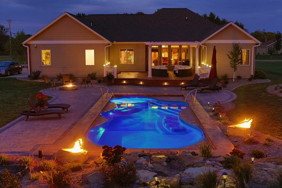 The San Juan Pleasuer Island Fiberglass Pool in Iridium Blue with deck on deck automatic pool cover