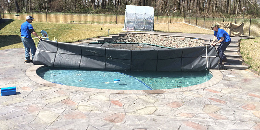 The finishing touches on a pool closing. The Safety Cover Installation