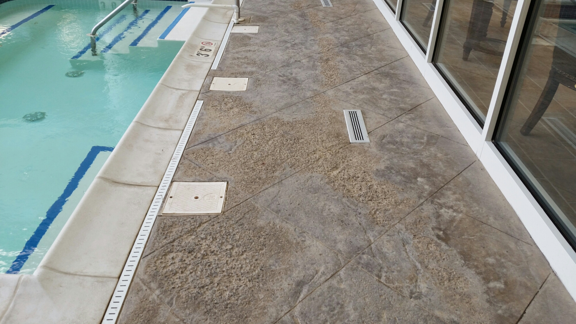This pool is pitted and etched from salt water from the pool.