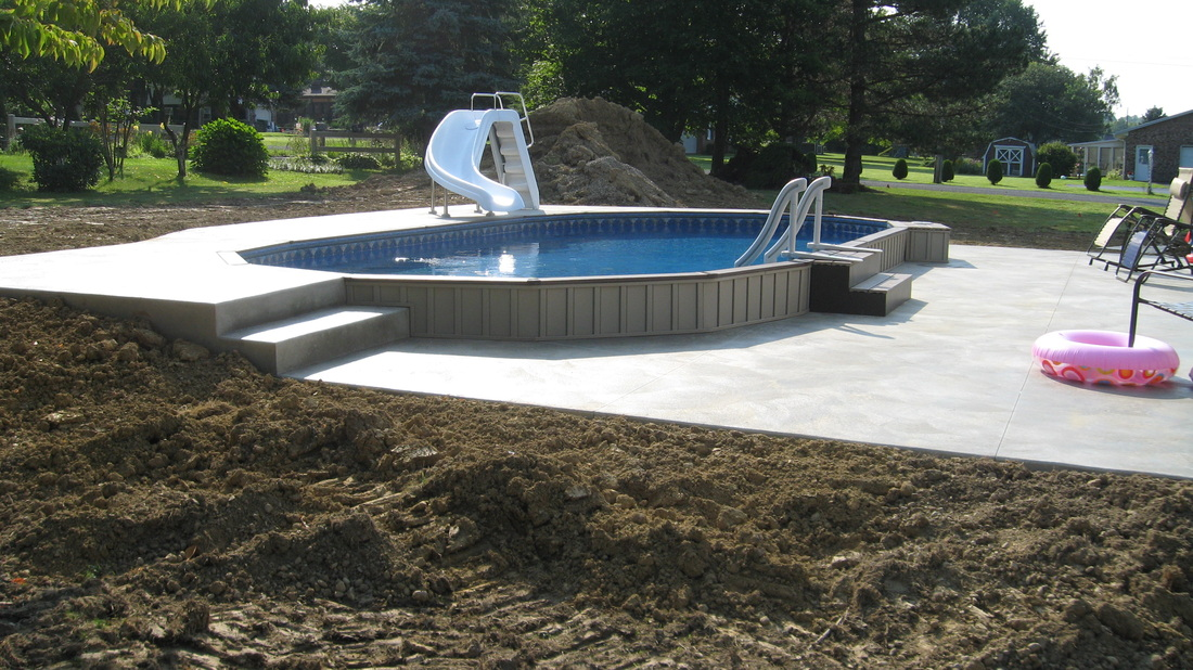 This Oval Fox Ultimate Pool is installed Partially In Ground.