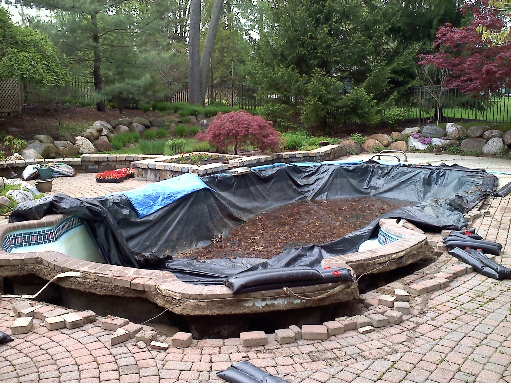 This is a fiberglass pool that was floated due to hydrostatic pressure in the ground.