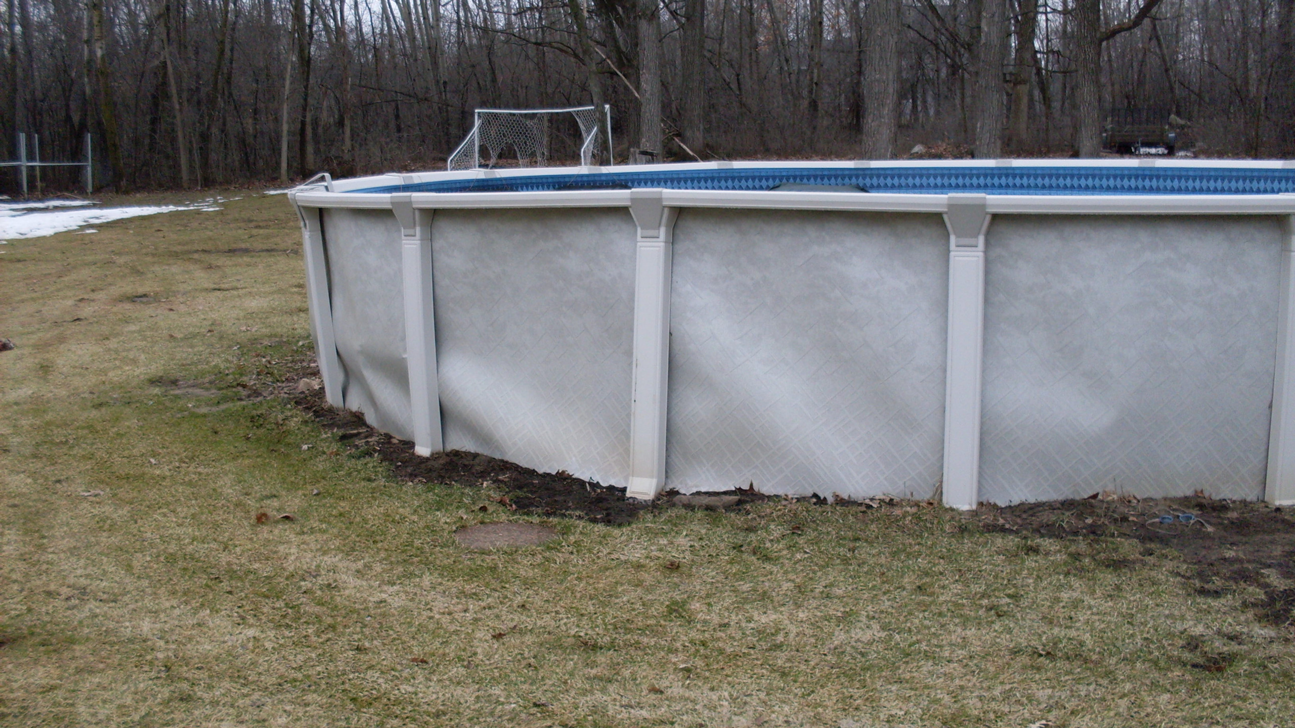 This above Ground Pool is permanently destroyed because the builder chose to use patio blocks under the uprights.