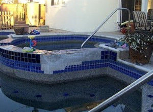 Repairs to tile on a concrete pool