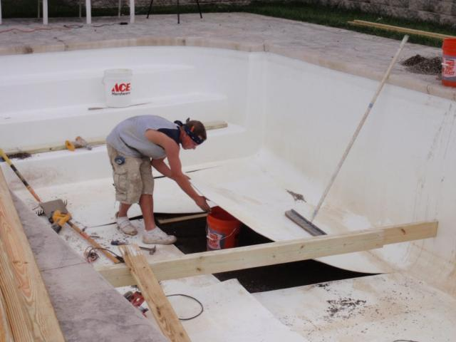 This is another fiberglass pool buitl with a sand base that experienced sad movement causign damage to the floor.