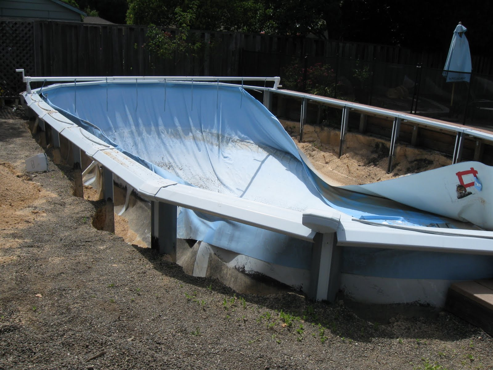 This is a photo of a Doughboy Above Ground Pool that was buried in the ground. As soon as the water was removed the pool collapsed under the weight of the backfill.