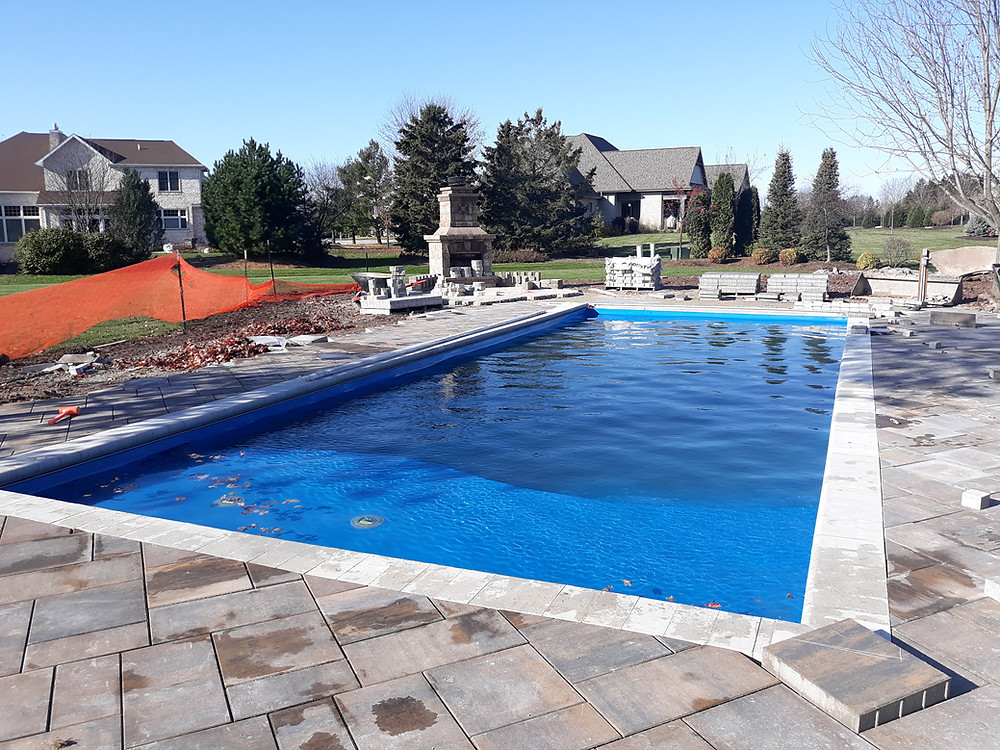 Pool Coping Installation on a D Series Fiberglass Pool from River Pools in Appleton WI