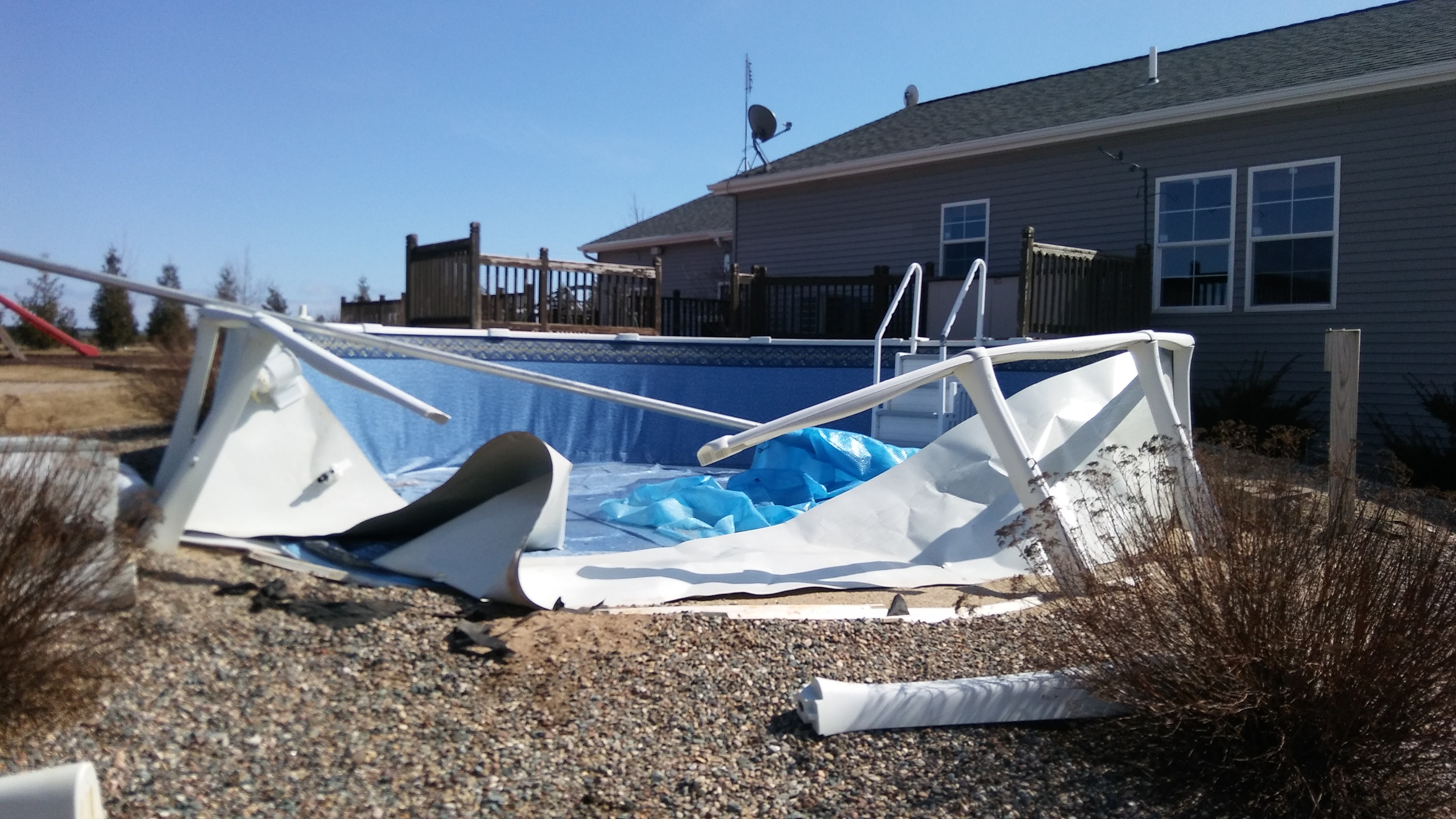 This Vogue Above Ground Pool Purchased from Poolworks was built in Algoma, WI buy the homeowner. The pool was damaged due to use of patio blocks during installation.