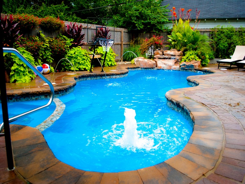The San Juan Desert Springs Fiberglass Pool in Lagoon Blue with paver patio
