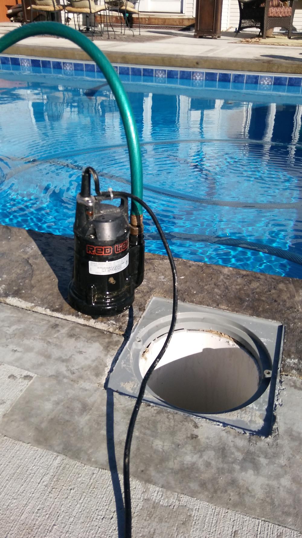Sump Pump and exposed sump pipe on a fiberglass pool