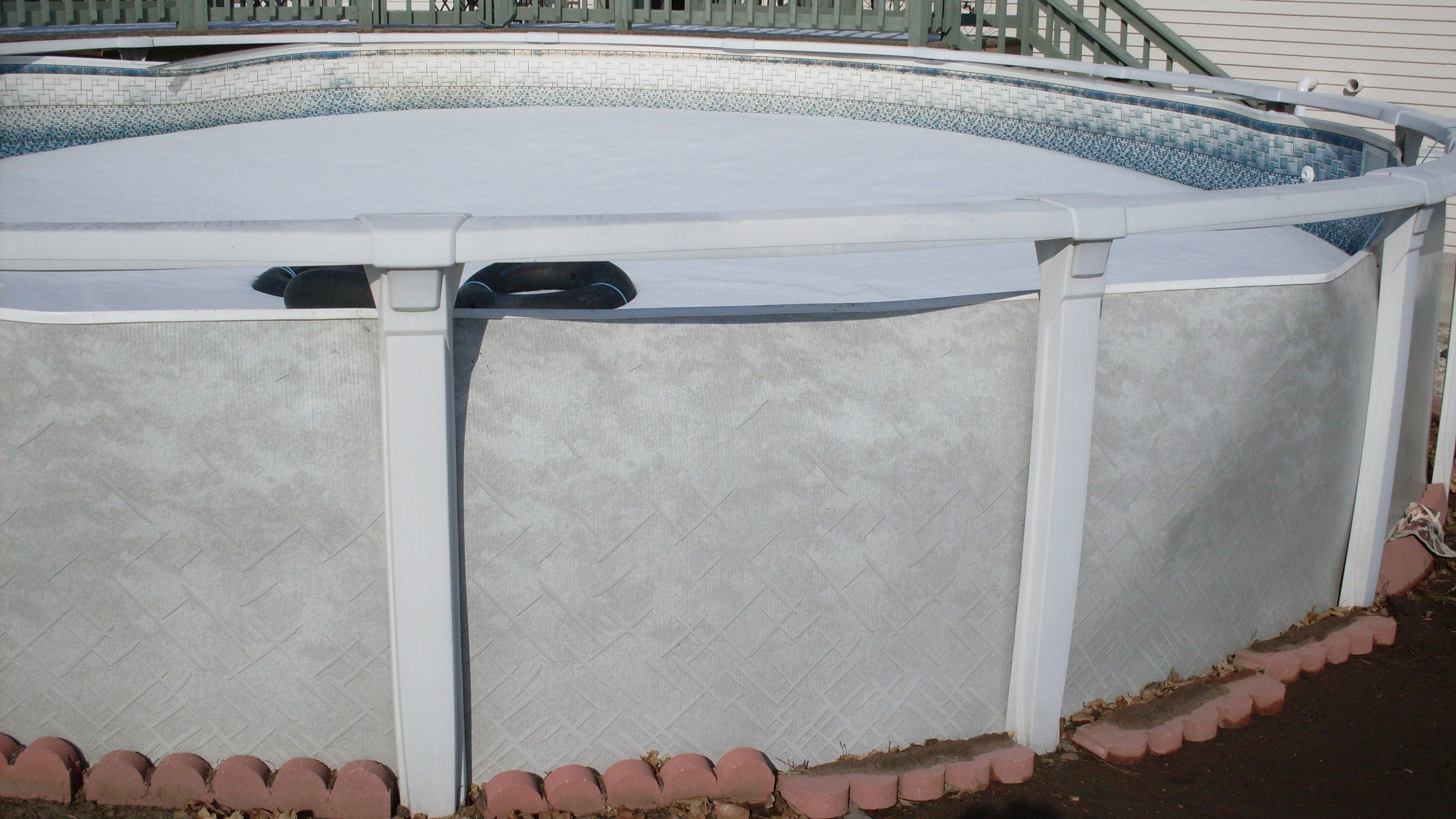This Aqualeader above ground pool was built in Green Bay, WI and failed due to damage from the use of patio blocks during the installation process.