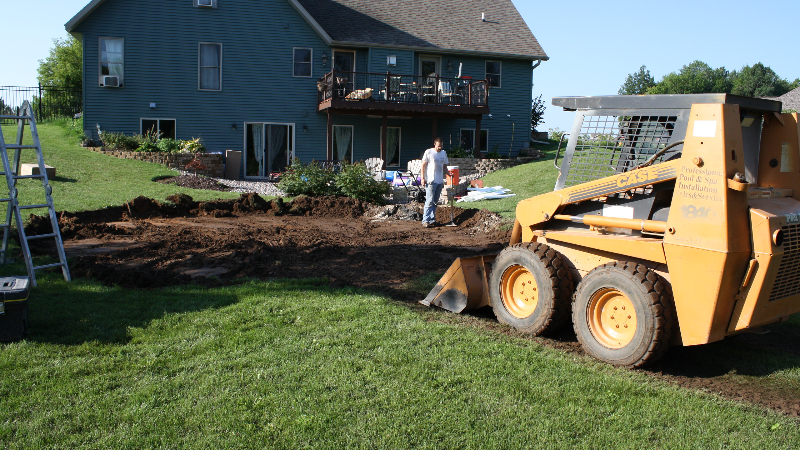 The next step is to begin the excavation of your above gorund pool. We mark out hte perimeter of the pool and use the lowest point on that perimeter as grade. This ensures your pool is on solid virgin ground. It takes longer but results in a solid foundation.