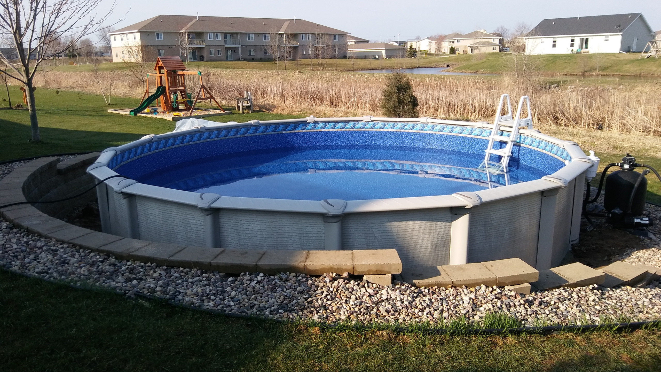 "Another beautiflu 27' Round Evolution Above Ground Pool from Pool Pros. This pool was another "" Pool Only"" Pakcage to replace a Brisbane Above Ground Pool purchased and built by Pool Team in Kaukauna WI."