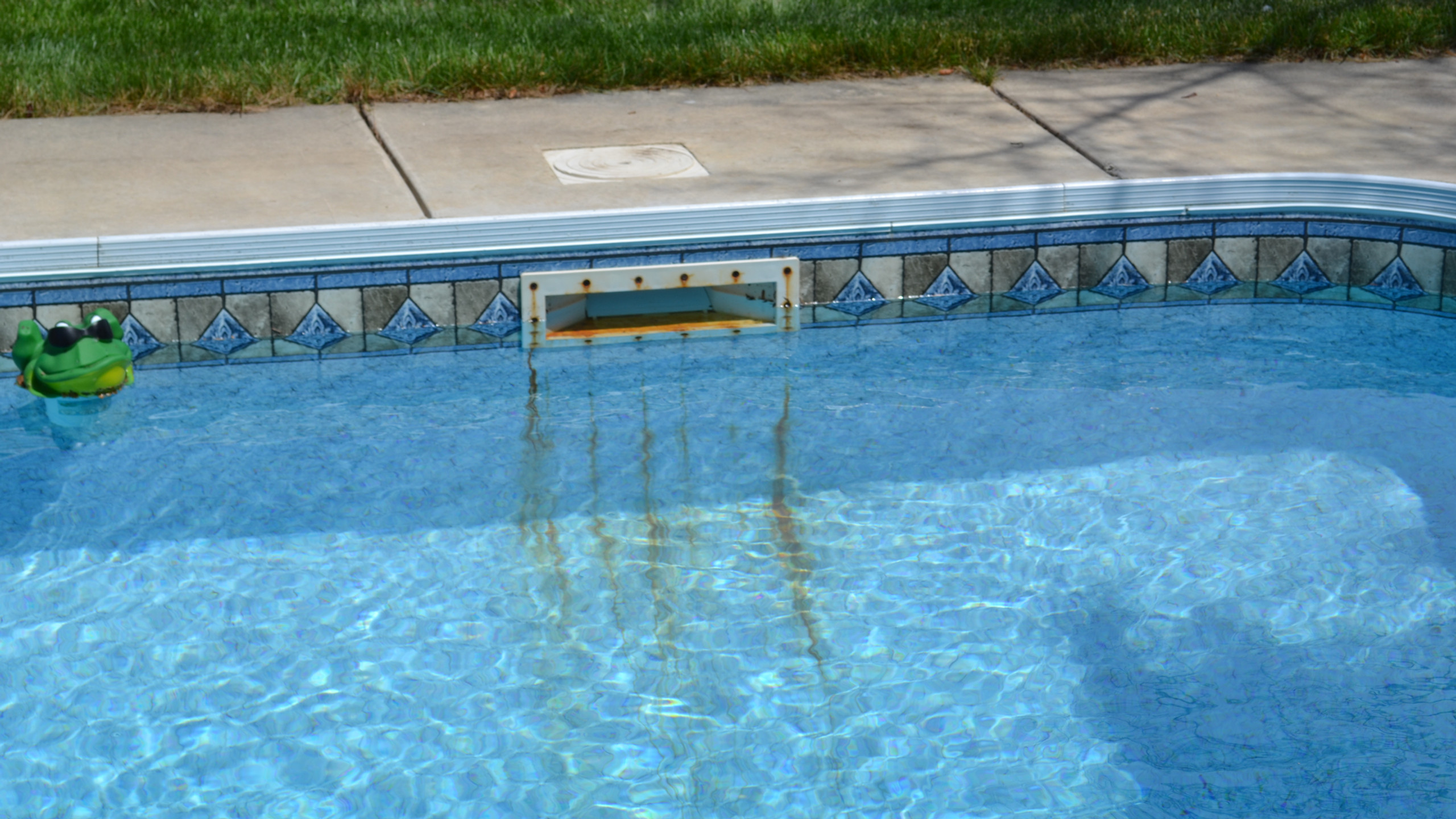 This pool is experiencing corrosion of the stainless steel skimmer screws that attach the faceplate to the skimmer in a salt water pool.