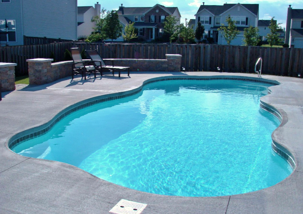 The San Juan Stardust Fiberglass Pool in white with waterline tile and broom finished concrete pool deck