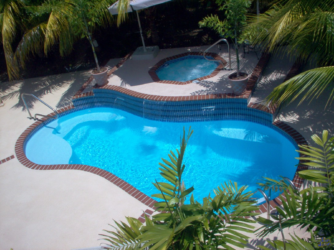 The San Juan Sundial Fiberglass Pool in Sully Blue with Raised Spa and water feature