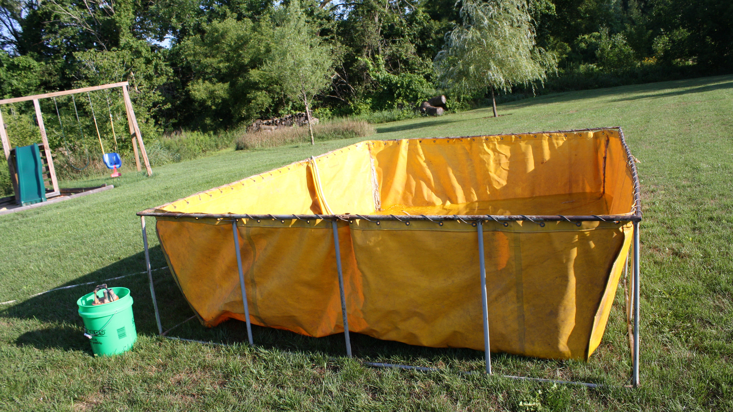 The first step in our process is to set up our portable holding tanks and begin filling them from the clients source while we build the pool.