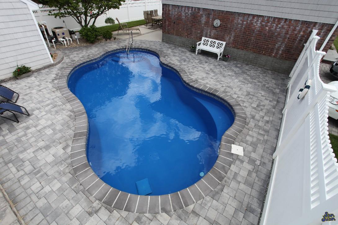 The San Juan Rio Pool in Blue Iridium with paver patio