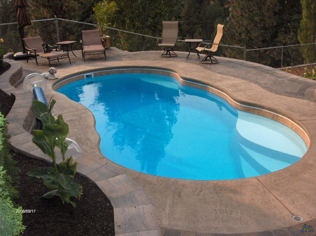 The San Juan Lelani Fiberglass Pool in White with waterline tile and stamped concrete pool deck