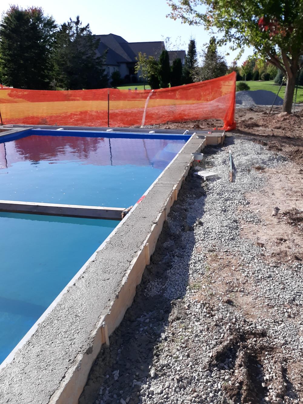 Freshly poured concrete bond beam for this Fiberglass Pool in Appleton WI