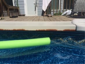 This above ground pool is damaged by a salt water system