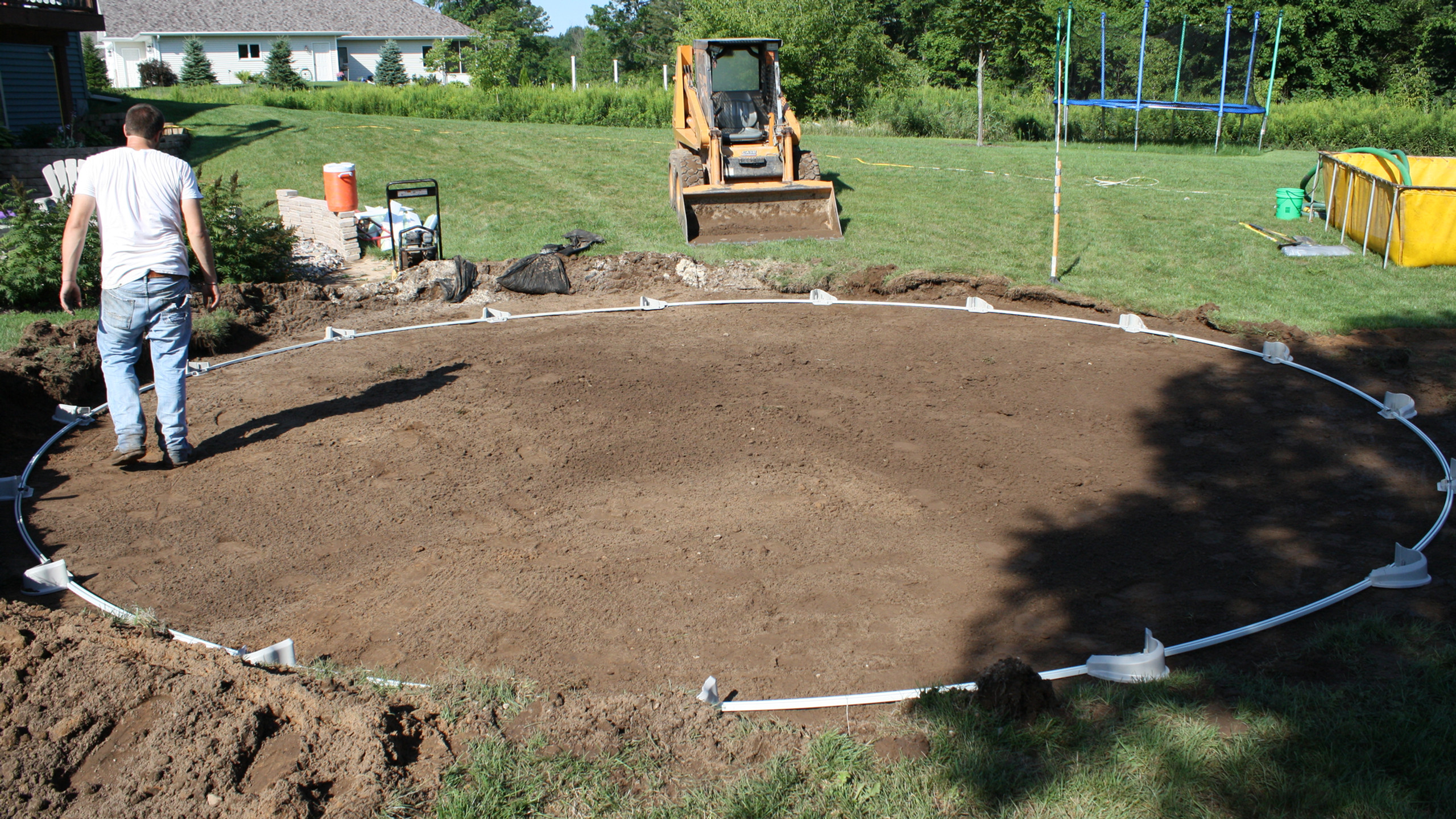At this point we assemble the bottom track and take a series of measurements to ensure the pool is perfectly round.
